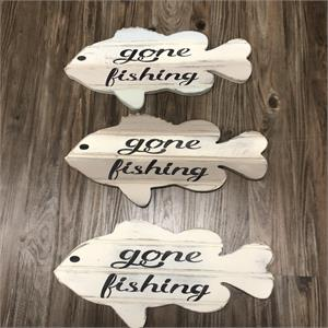 laser engraved on fish shape peice of ash wood Gone Fishing